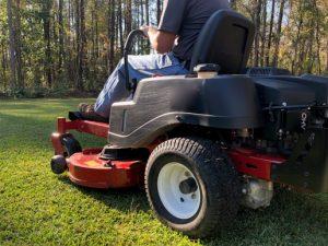 Man driving a lawn mow